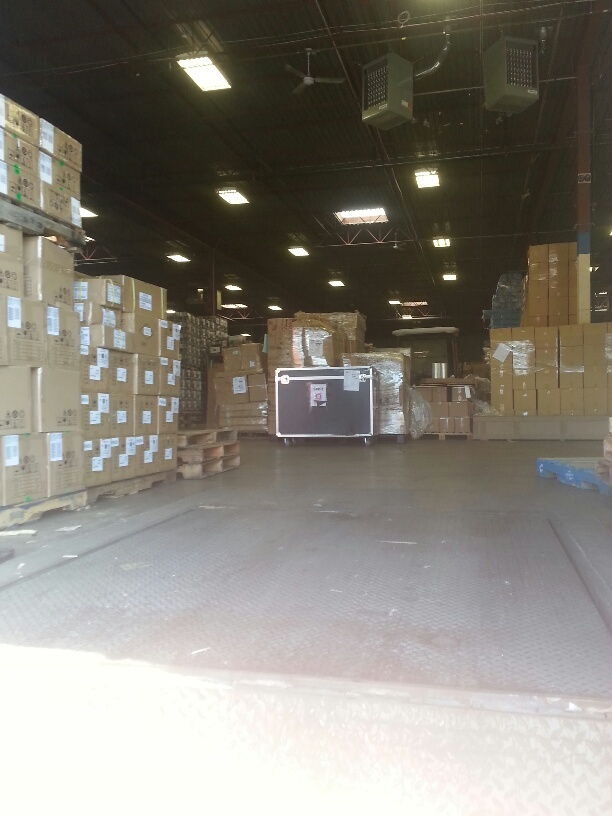 Picture:  Our big box in the warehouse.  So near and yet so unobtainable.